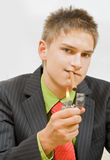 Smoker. Young businessman smokes a big cigar Royalty Free Stock Images