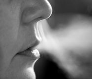 Smoker blowing smoke Royalty Free Stock Images
