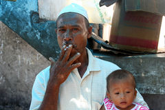 Smoker with a child Stock Photo