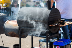 Smoker. Denver, Colorado, USA-August 30, 2014. Large barbecue smoker cooking meat stock photo