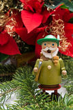 Smoker. German incense smoker and Christmas flower Royalty Free Stock Photography
