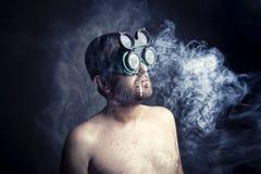 Smoker Man. Portrait of crazy smoker man in studio Stock Photos