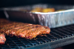 Smoker. Meat prepared in barbecue smoker for competition stock images