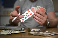 Smoker playing cards Royalty Free Stock Photography
