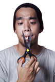 Smoker try to quit smoking. Asian smoker cutting the last cigarette to quit smoking Royalty Free Stock Photography