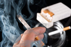Smokers hand Royalty Free Stock Photography