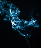 Smokes on black background Royalty Free Stock Images