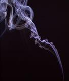 Smokes on black background Stock Image
