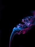 Smokes on black background Stock Photo