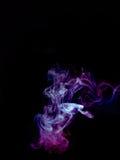 Smokes on black background Royalty Free Stock Photos