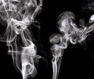 Smokes on black background Royalty Free Stock Photo