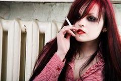She smokes a cigarette Stock Photography