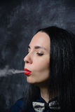 Smokes woman Stock Images