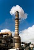 Smokestack. Industrial factory smokestack billowing smoke Stock Photo