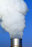 Smokestack. An industrial smokestack releasing steam into the air Stock Photography
