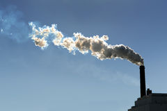 Smokestack Billowing Smoke. Into the atmosphere Stock Photography
