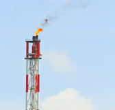 Smokestack burning flare Royalty Free Stock Photography