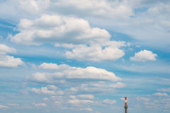 Smokestack chimney industry pollute blue sky clouds. Smoke stack chimney industrial pollution environment climate air ecology blue sky clouds Stock Photos