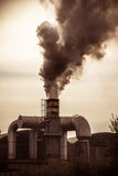 Smokestack. A smokestack erupting toxic fumes in the atmosphere Stock Images