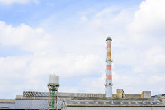 Smokestack in factory Stock Images