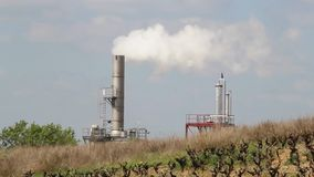 Smokestack of industrial factory Stock Images