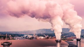 Smokestack pipe factory pollution in the city, Fuel Power Plant Smokestacks Emit Carbon Dioxide Pollution.  royalty free stock photography
