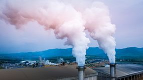 Smokestack pipe factory pollution in the city, Fuel Power Plant Smokestacks Emit Carbon Dioxide Pollution.  stock images