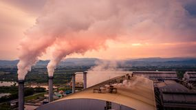 Smokestack pipe factory pollution in the city, Fuel Power Plant Smokestacks Emit Carbon Dioxide Pollution.  royalty free stock image