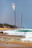 Smokestack pipe factory on the shore Royalty Free Stock Photos