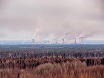 Smokestack that pollute atmosphere. Smokestack that pollute the atmosphere. Ecological catastrophy. Polar tundra, deep autumn Royalty Free Stock Photos