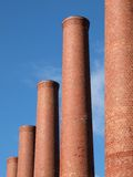 Smokestack Row. Brick smokestacks on a bright clear day Stock Photos