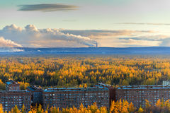 Smokestack smokestacks that pollute the atmosphere. Ecological catastrophy. Polar tundra, deep autumn. Sunset, bad lighting conditions Royalty Free Stock Photography