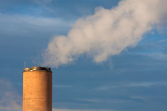 Smokestack with steam Royalty Free Stock Photo