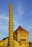 Smokestack and townhouses in old factory Stock Images