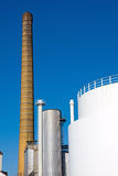 Smokestack and white industrial tank Stock Photography