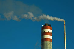 Smokestack at work. This is an example of air pollution at work. An smokestack take out smoke at a cellulose factory. Air pollution is contamination of the stock photo