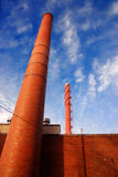 Smokestacks. Two smokestacks against a blue sky Royalty Free Stock Photography