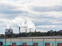 Smokestacks Beyond Commercial Area Imagen de archivo libre de regalías