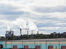 Smokestacks Beyond Commercial Area Royalty Free Stock Image