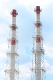 Smokestacks and blue sky Royalty Free Stock Images
