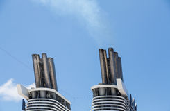 Smokestacks on Cruise Ship in Blue Sky Royalty Free Stock Image