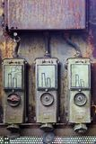 Smokestacks illustrated on metal boxes Stock Images