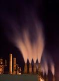 Smokestacks na noite Imagem de Stock Royalty Free