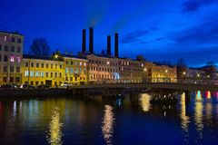 Smokestacks in the old town. Night cityscape with old houses and stacks Royalty Free Stock Photos