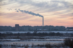 Smokestacks polluting. The city in a winter day stock photography