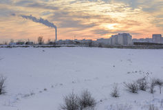 Smokestacks polluting. The city in a winter day stock images
