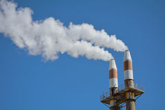 Smokestacks polluting the sky Royalty Free Stock Image