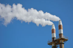 Smokestacks polluting the sky Royalty Free Stock Images