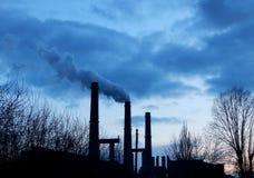 Smokestacks smokes in the night sky. Factory with smokestacks smokes in the night sky Stock Image