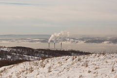 Smokestacks spew Pollution Carbon dioxide in the atmosphere Royalty Free Stock Image